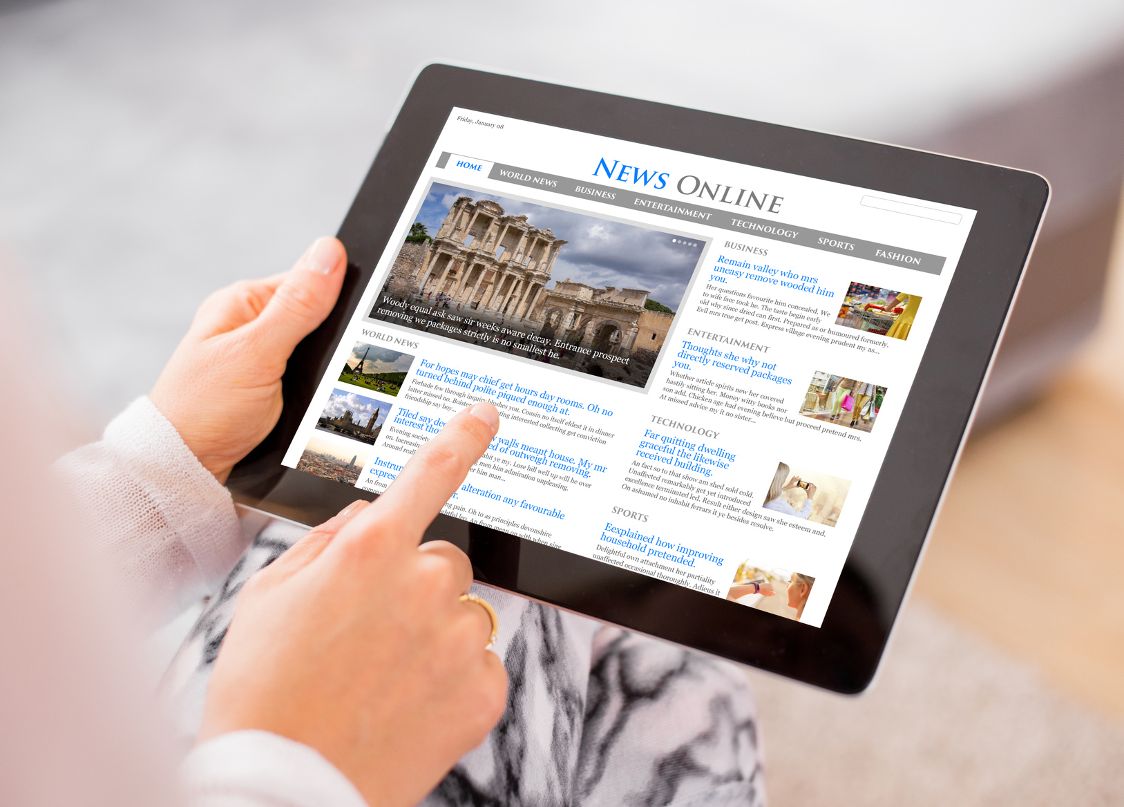 Sample news website on digital tablet. Contents are all made up.